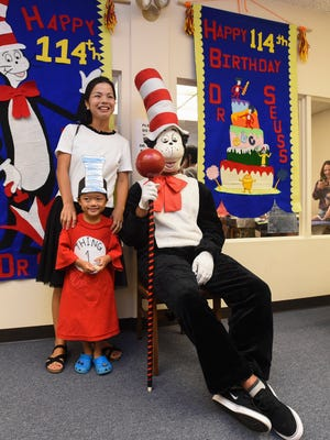 "Yujin Hagio, his mom, Katsura Hagio, and The Cat  from Dr. Seuss' ""The Cat in the Hat"" at Dr. Seuss' 114th Birthday Celebration at the Nieves M. Flores Memorial Library are shown in this March 3, 2018, file photo."