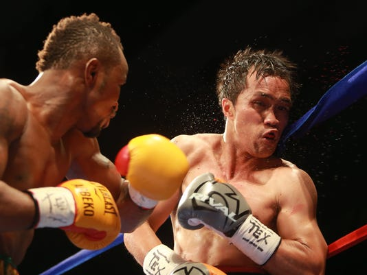 VICTOR CALZADA-EL PASO TIMES Blood and sweat spray from Juanito Rubillar's head after a shot by Joseph Agbeko during the second round Saturday at the El Paso County Coliseum.