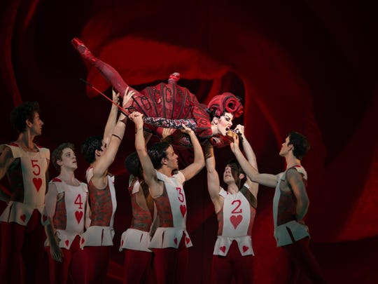"""Cincinnati Ballet principal dancer Sarah Hairston performs as the Queen of Hearts in the company's 2015 production of choreographer Septime Webre's """"ALICE (in wonderland)."""""""