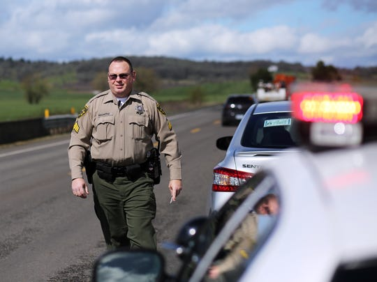 Sgt. Mike Holsapple of the Polk County Sheriff's Office patrols Highway 99W north of Rickreall.