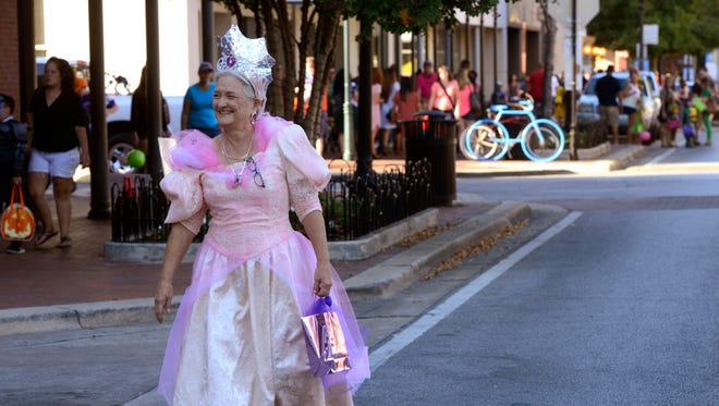 A trick-or-treater walks down Palafox Place during a recent Downtown Trick or Treat in Pensacola. You're never too old to trick or treat, according to PNJ columnist Troy Moon.