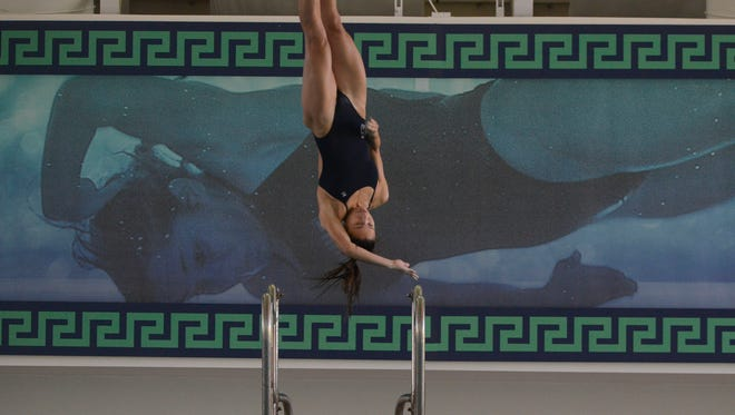 West Florida's Monica Amaral makes her first dive Saturday during the UWF Swimming and Diving meet against Ouachita Baptist at the UWF Aquatic Center.