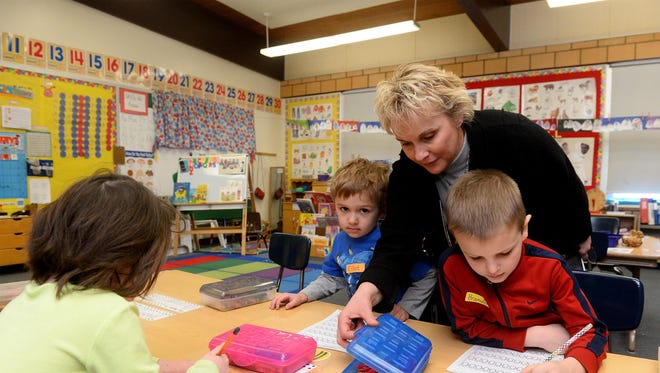 Ruth Uecker, assistant superintendent for K-6 in Great Falls, works with kindergartners while guest teaching at Chief Joseph Elementary School on Friday. Uecker has been honored with the 2017 Adrian Langstaff Award.