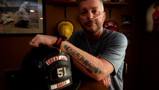 """Jason Baker, a Great Falls Firefighter, is battling stage 4 lung cancer, which he believes is related to his seventeen year career as a firefighter. Jason's daughter designed the inspirational phrase """"Carry on Warrior"""" for him, which he later tattooed on his forearm."""