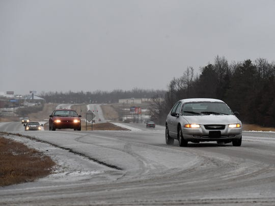 Vehicles travel on a slush-covered Sheid-Hopper Bypass early Wednesday afternoon.