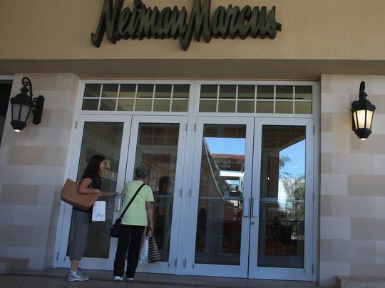 Consumers outside a Neiman Marcus store in Coral Gables, Fla.