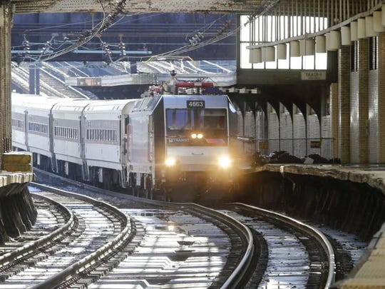 A train approaches the New Jersey Transit Newark Penn Station stop Friday, March 4, 2016, in Newark, N.J. Representatives from New Jersey Transit and rail unions meet in Washington to try and reach a contract agreement before a strike deadline this weekend.