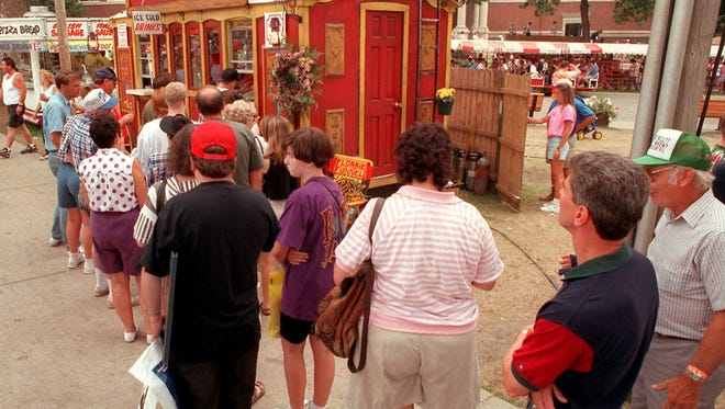 A line forms at Florrie's Funnel Cakes during the 1996 Iowa State Fair, where, earlier that week, Bobie and Marilyn Blewer, owners of the stand, were shot and killed. Lines were so long that two of the Blewers' children, Beau and Jada, recruited workers and volunteers to keep up with the demand.