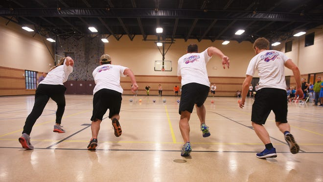 Argus Leader, Keloland, Howalt+McDowell and Lawrence and Schiller participate in a dodgeball game Tuesday, Aug. 15, at Central Baptist Church. The companies bought raffle tickets for prizes. Money goes towards the annual Heart Walk.