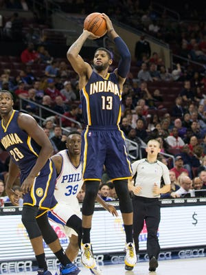Indiana Pacers forward Paul George (13) hits a three pointer past Philadelphia 76ers forward Jerami Grant (39) during the second quarter at Wells Fargo Center.