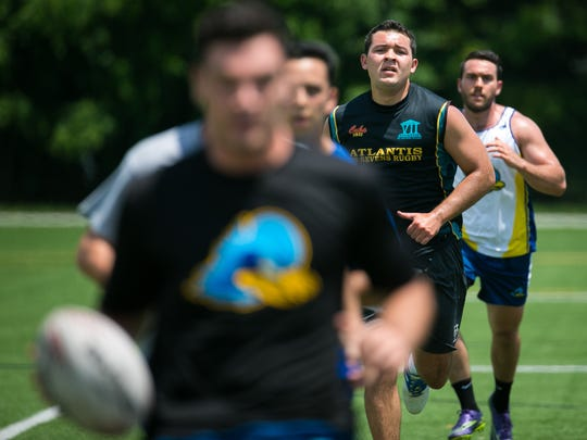 Team captain Chris Mattina runs drills with his teammates at Frazer Field as the UD Men's Rugby Club practice for this weekend's College Championships in Philadelphia.