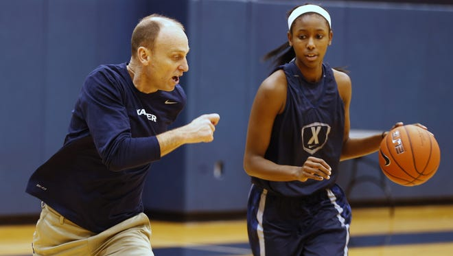 Xavier women's basketball coach Brian Neal, working here with senior Maddison Blackwell, is at the helm of the program for the fourth year. The Musketeers start the 2016-17 season Nov. 12 by hosting Tennessee State in the Lauren Hill Classic at Cintas Center.
