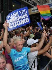 Gay marriage activists in New York thank their governor