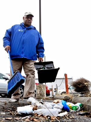 Downtown Inc. Clean-up Crew Member Larry Richards encounters a a pile of litter near businesses along Market Street in what is designated as zone three in York City, Wednesday, March 23, 2016. Dawn J. Sagert photo