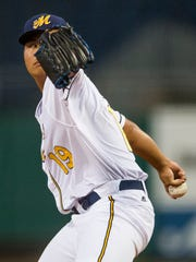 Biscuit pitcher Chih-Wei Hu throws during the Montgomery