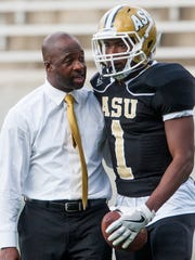 Alabama State football coach Brian Jenkins talks with Josh Davis before the Texas Southern game in Montgomery, Ala., on Saturday September 24, 2016.