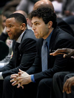 February 13, 2016 - Dejected University of Memphis  head coach Josh Pastner (right) looks on from the bench during a 94-87 overtime loss to Tulane University at Fogelman Arena in Devlin Fieldhouse in New Orleans, La. Memphis is now 5-7 in AAC conference play. (Mark Weber/The Commercial Appeal)