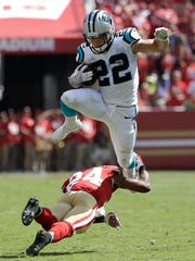 Carolina Panthers running back Christian McCaffrey (22) jumps over San Francisco 49ers defensive back K'Waun Williams (24) during the first half of an NFL football game in Santa Clara, Calif.