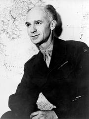 World War II correspondent Ernie Pyle poses March 1, 1945, at an unknown location. He was born in Dana, Ind.