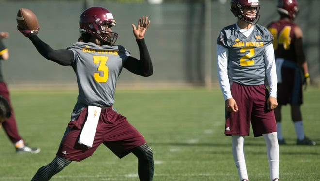 ASU quarterback Bryce Perkins throws a pass during spring football practice on March 16, 2016.