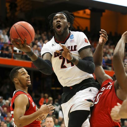 U of L's Montrezl Harrell, #24, gets by NC State defenders