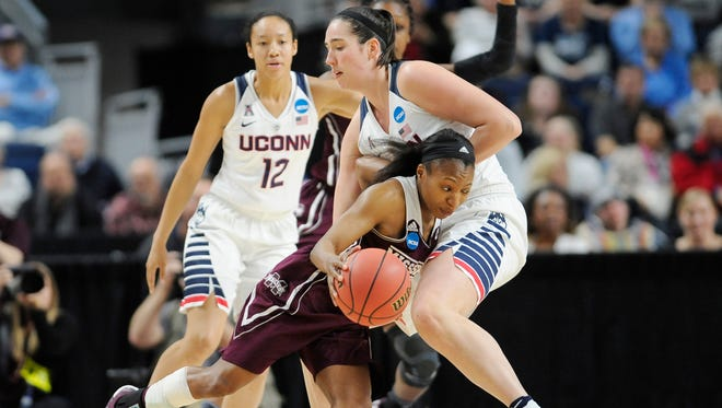 Mississippi State's Morgan William tries to drive past Connecticut's Natalie Butler as Saniya Chong (12) defends during the second half of Saturday's Sweet 16 matchup.