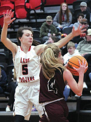 Caney Valley's Paige Urquhart, left, pressures an opposing player during prep hoops action last winter. Mike Tupa/Examiner-Enterprise