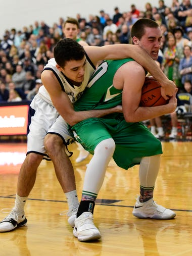 Margaretta's Nick Leibacher, right, wrestles to keep