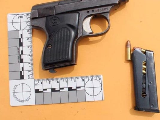635996069879082199-seized-gun.JPG