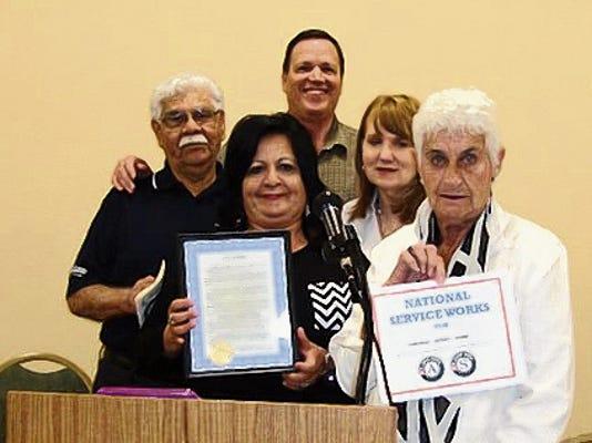 Lina Molina, front left, Carlsbad program director, and Marge Buckner, advisory board president. Councilman Nick Salcido, back left; Jim Grantner, board member; and Sherra Hester, director.