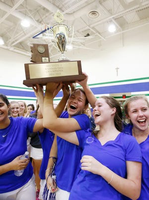 Xavier Prep's Baani Khurana (left), Mallory Belknap, Laura Pearl and Teal Weaver (right) celebrate their high school badminton team championship on Oct. 28, 2014 at Xavier College Prep in Phoenix, AZ.  Xavier defeated Perry High.