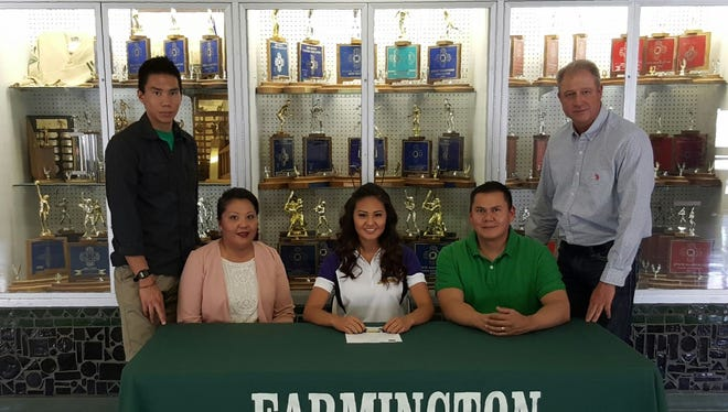 Georgia Willie signed a letter of intent to play volleyball for Haskell Indian Nations University on Tuesday at Farmington High.