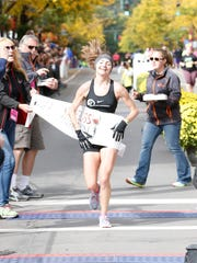 Molly Nunn, of North Carolina, breaks the finish line