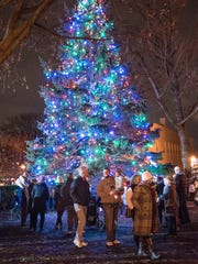 Plymouth's tree is lit and the holiday season begins.