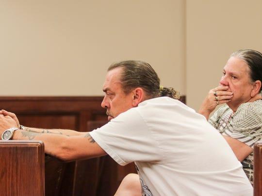 Clinton Hunter Jr., listens as Judge Ray Grimes revokes