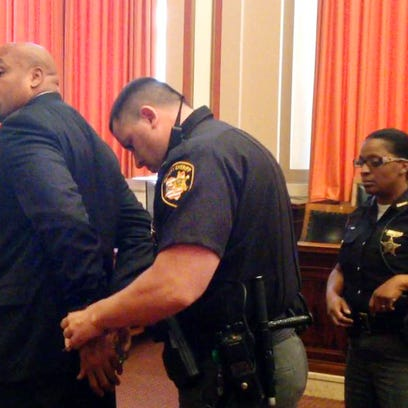 Darrell Beavers is handcuffed to go to prison after