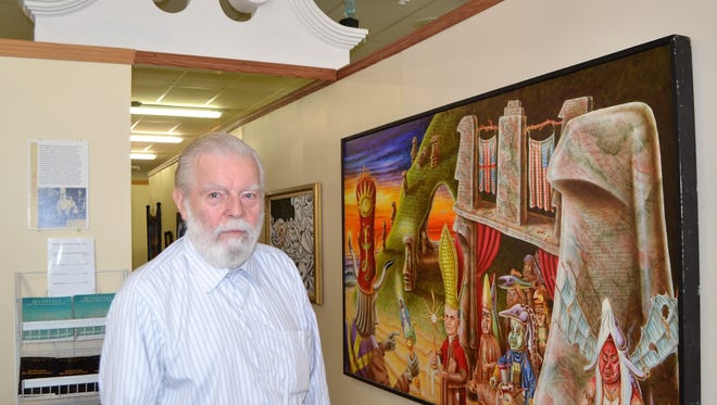 Norbert Kox stands at the entrance of a display of his work at the his Apocalypse House and NEW Museum of Visionary Art, which opens June 30, 2018 in Gillett. Kox, who has been painting for 50 years, died Dec. 29.