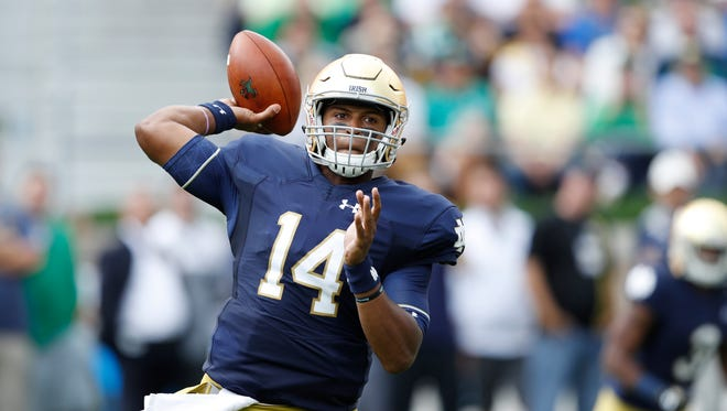 DeShone Kizer #14 of the Notre Dame Fighting Irish passes against the Nevada Wolf Pack in the first half of the game at Notre Dame Stadium on September 10, 2016 in South Bend, Indiana.