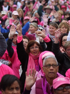 2015: Breast cancer survivors gather in front of the stage for a tribute during the Susan G. Komen Race for the Cure at Six Flags Great Adventure, Sunday, October 4, 2015, in Jackson.