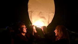 Karina Bland and her son Sawyer sent a paper sky lantern into the air on Christmas Eve.