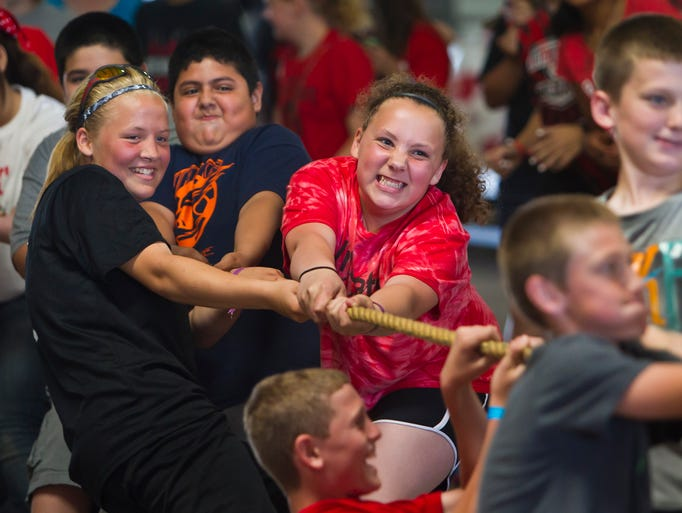 Southwestern Middle School sixth grade students pull with all of their might during the tug-of-war against the seventh grade Thursday, May 29, 2014, during the school's field day at the Tippecanoe County Fairgrounds in Lafayette.