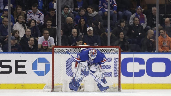 Henrik Lundqvist's first game in 27 days didn't bode as the Flyers scored three times in the first period and the Rangers fell 5-3.