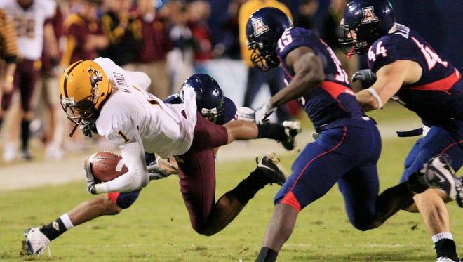 Arizona State's Michael Jones dives for extra yards against Arizona in Tucson on Dec. 6, 2008.