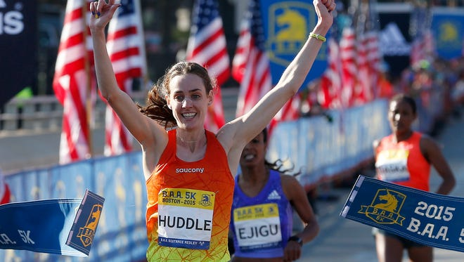 Molly Huddle wins the women's division of the Boston Marathon 5k in Boston on Saturday.