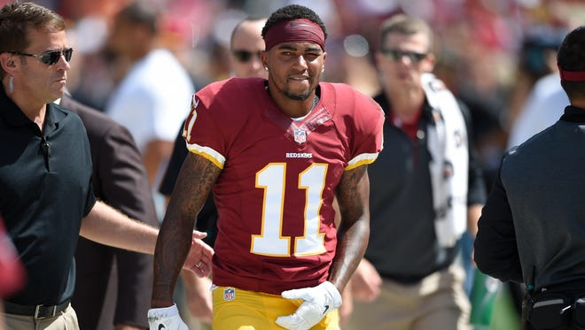 Washington Redskins wide receiver DeSean Jackson (11) walks after being injured during the first half of an NFL football game against the Jacksonville Jaguars, Sunday, Sept. 14, 2014, in Landover, Md.