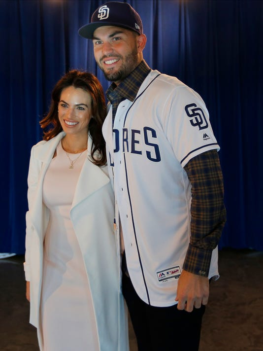 San Diego Padres first baseman Eric Hosmer poses for a photo with his girlfriend Kacie McDonnell during a news conference, Tuesday, Feb. 20, 2018 in Peoria, Ariz. (K.C. Alfred/The San Diego Union-Tribune via AP)