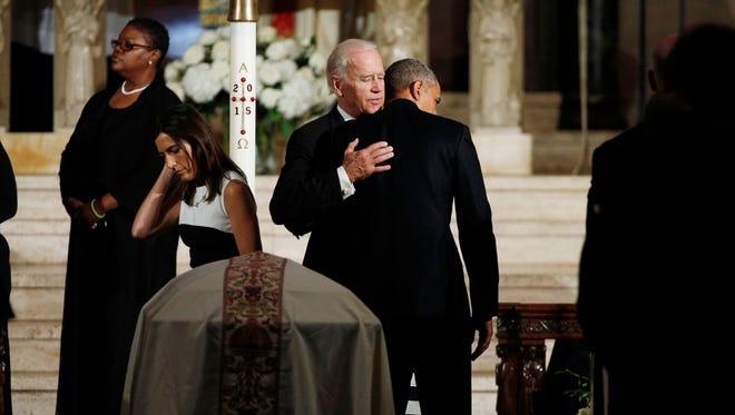 Vice President Joe Biden and President Barack Obama hug during funeral services for Biden's son, Beau Biden, Saturday, June 6, 2015, at St. Anthony of Padua Roman Catholic Church in Wilmington, Del.