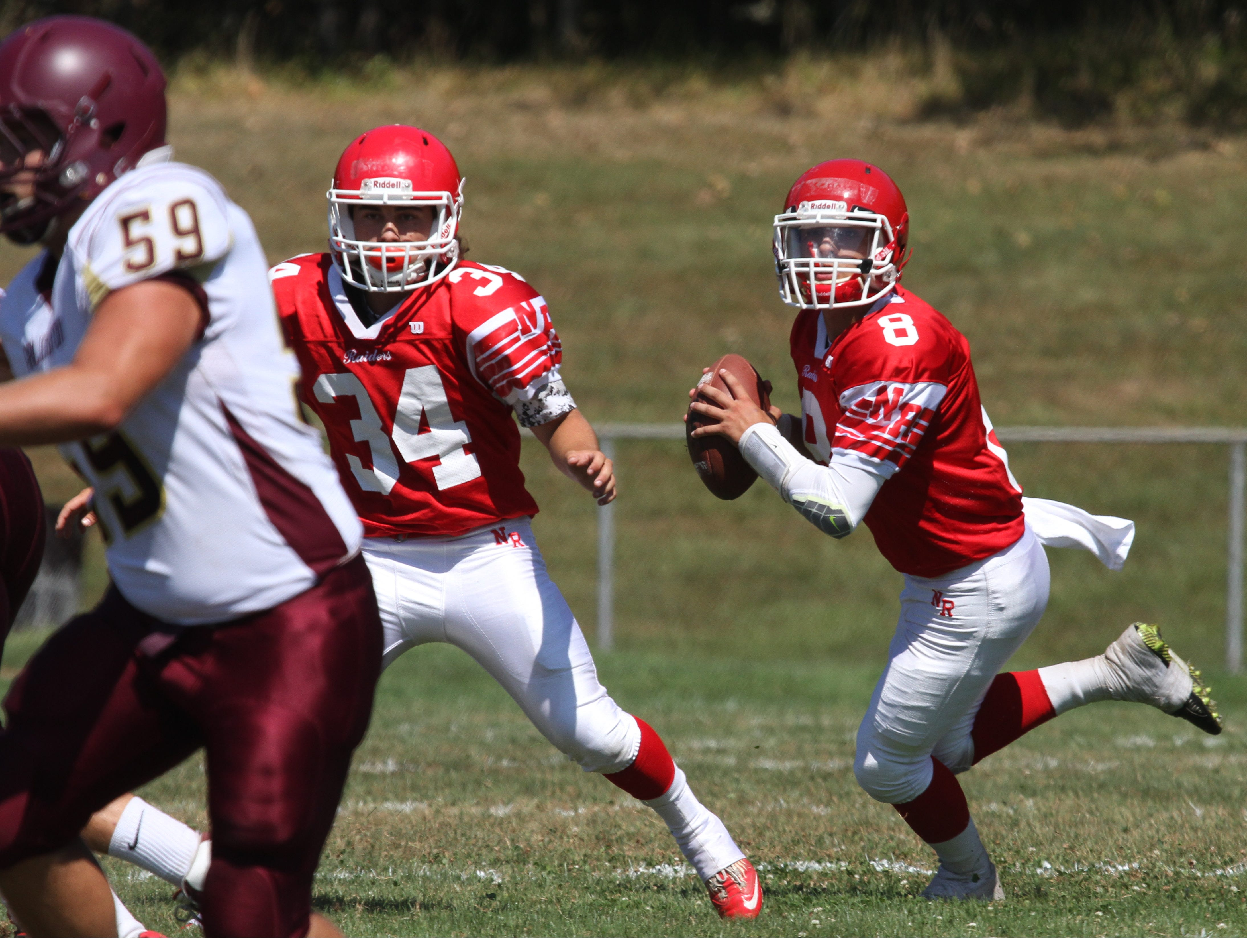 North Rockland quarterback Dylan Senatore looks for an opening during action in the home opener between North Rockland and Arlington at North Rockland High School, Sept. 5, 2015.