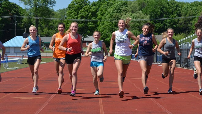 The Harper Creek girls track team has gone undefeated in league meets for four years, won five straight league titles and three straight regional crowns and heads into the state meet with 10 qualifiers, including senior captains Catie Scott and Emma Berning (front, center).