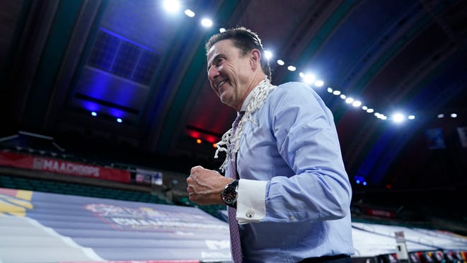 Iona head coach Rick Pitino celebrates as he walks off the court after Iona won an NCAA college basketball game against Fairfield during the finals of the Metro Atlantic Athletic Conference tournament, Saturday, March 13, 2021, in Atlantic City, N.J. (AP Photo/Matt Slocum)